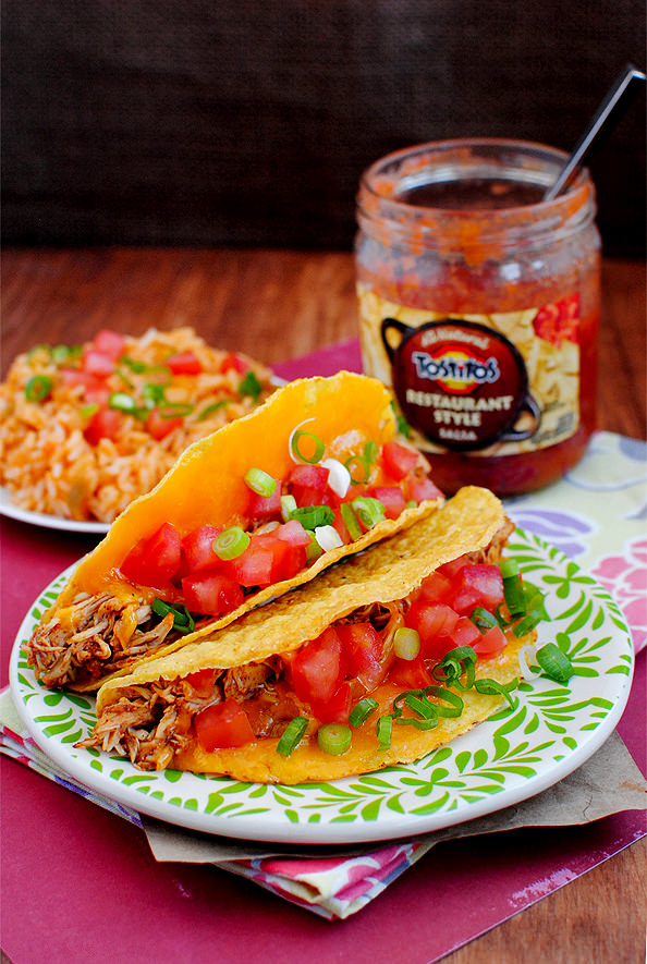 Photo of chicken tacos with Mexican Rice and jar of salsa