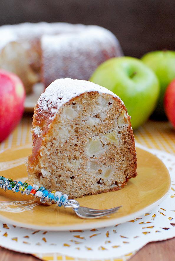 closeup photo of slice of fresh apple cake