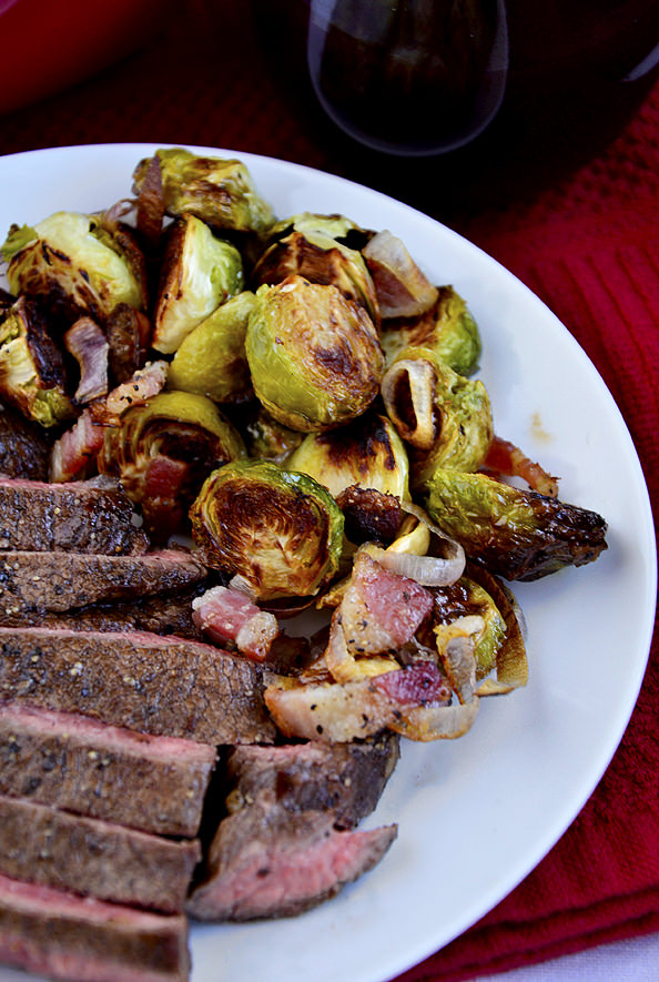 Roasted Brussels Sprouts with Bacon, Shallots, and Garlic are savory, salty, and so darn good. Serve as a delicious, gluten-free side dish with dinner. | iowagirleats.com