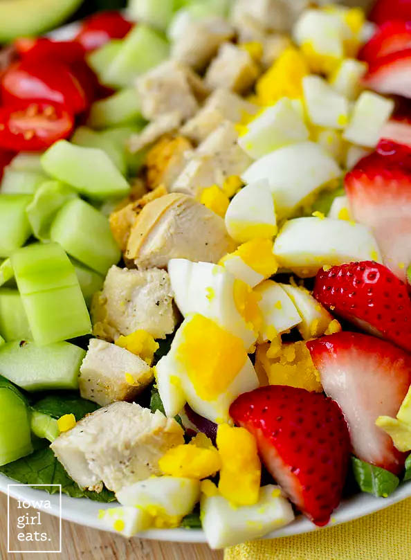 close up photo of fresh toppings on a cobb salad