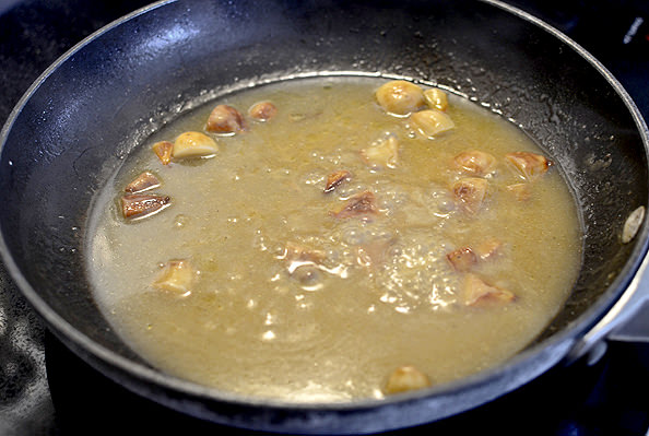 """... savory pan sauce studded with """"roasted"""" garlic cloves. Oh. YUM"""