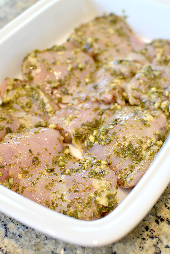 Baked Pesto Chicken Parmesan #chicken #chickenthighs #dinner | iowagirleats.com