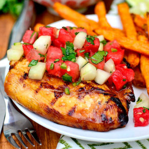 grilled chicken with cucumber watermelon salsa on a plate