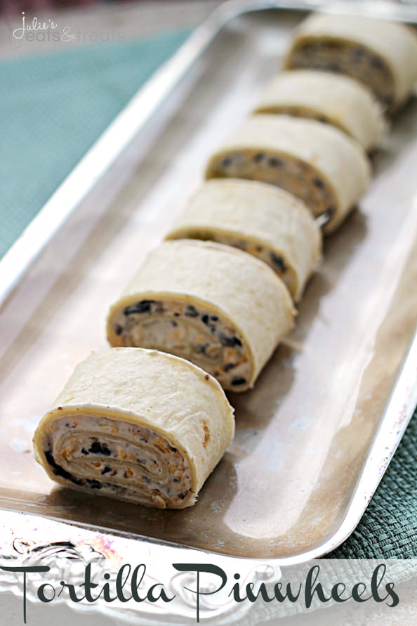 Tortilla-Pinwheels-Bite-sized-bites-stuffed-with-Black-Olives-Green-Chiles-Cheese-and-Cream-Cheese- copy_mini