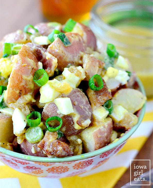 red potato salad without mayo in a serving bowl