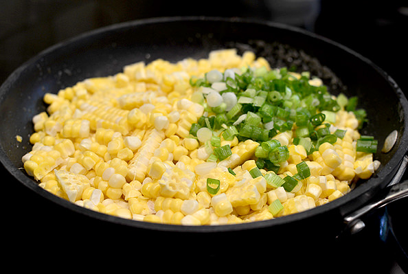 Sweet Corn with Bourbon-Maple Brown Butter and Bacon is a mouthwatering side dish bursting with layers of flavor! | iowagirleats.com