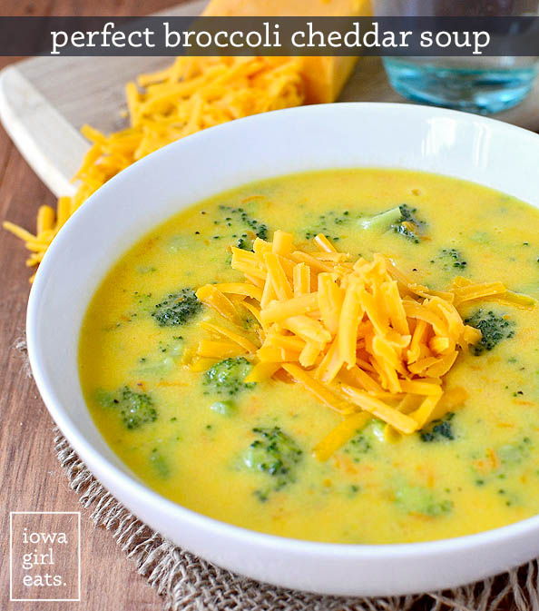 a bowl of perfect broccoli cheddar soup with shredded cheese on top