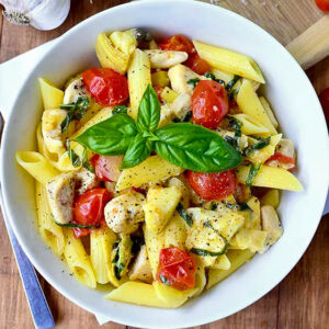 overhead photo of a bowl of mediterranean chicken pasta