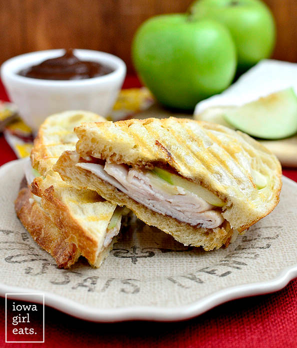 apple orchard panini sliced in half on a plate
