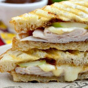 crispy gooey cheese and turkey panini