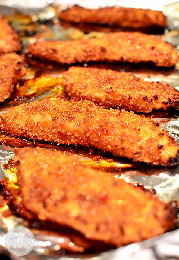 baked chicken fingers on a baking sheet