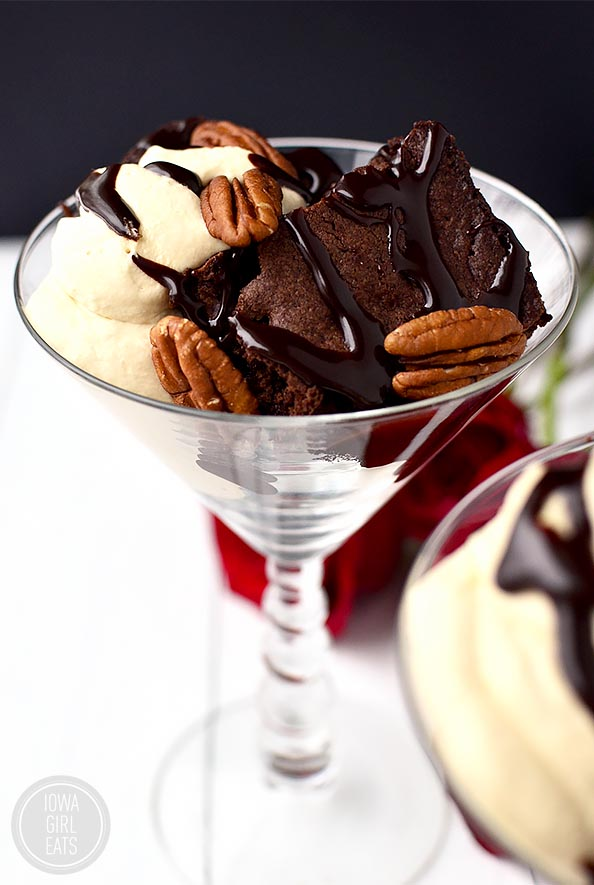 Gluten-Free Turtle Brownie Sundaes with Salted Caramel Whipped Cream and Homemade Hot Fudge Sauce #glutenfree #dessert #valentinesday | iowagirleats.com