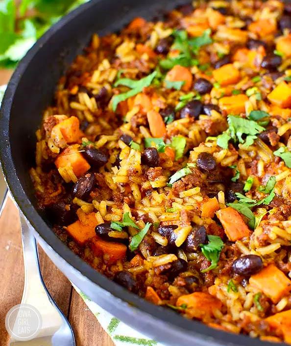 chorizo sweet potato black bean rice skillet topped with fresh cilantro