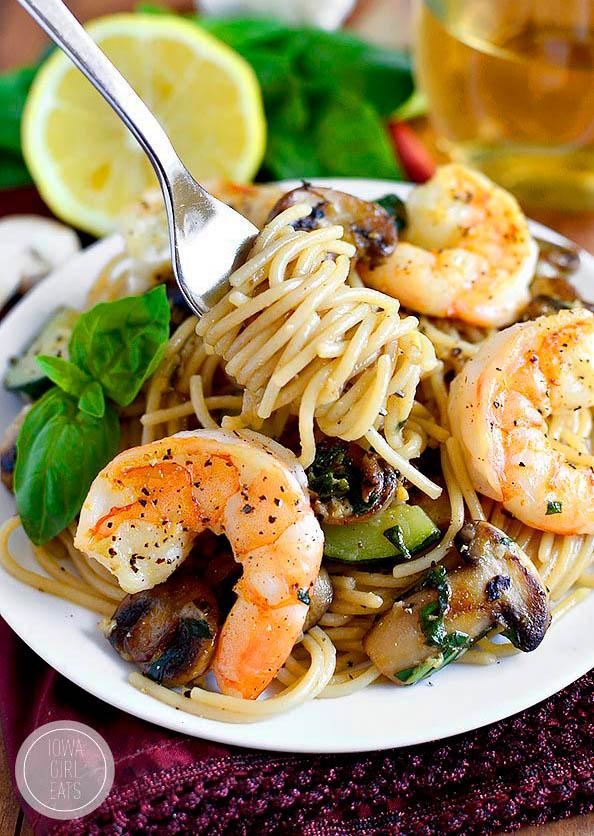 fork twirling pasta with shrimp and vegetables