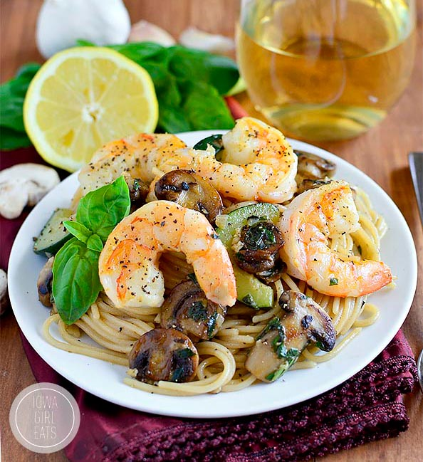 mushroom and zucchini shrimp pasta on a plate