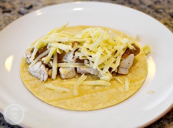 Roasted Poblano Salsa Chicken Enchiladas with Cucumber Pico de Gallo #glutenfree | iowagirleats.com
