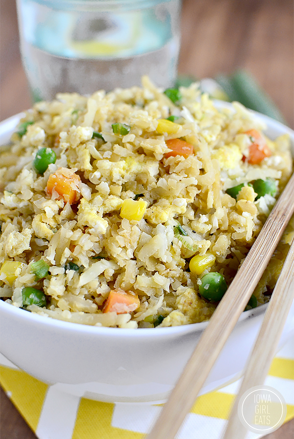 Cauliflower Fried Rice will trick your tastebuds in the best way possible. This grain-free, dairy-free, and vegetarian dish will be a hit at your house! #glutenfree #dairyfree | iowagirleats.com