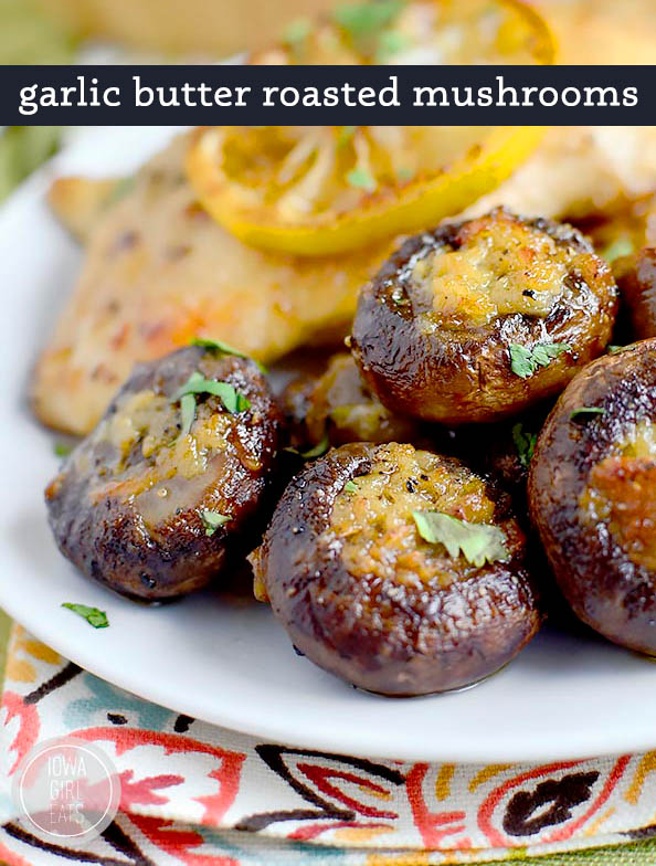 easy garlic butter roasted mushrooms on the side of a plate