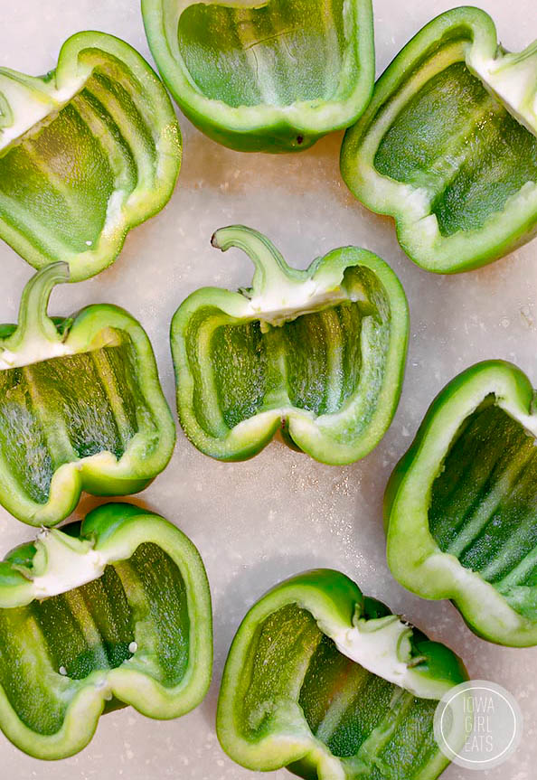 hallowed out green peppers on a cutting board for stuffed peppers