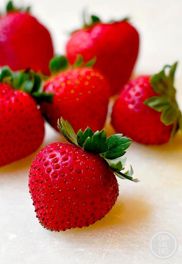 fresh strawberries on a cutting board