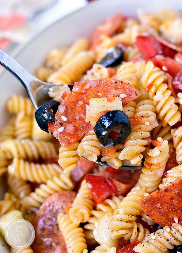 fork digging into a bowl of pasta salad