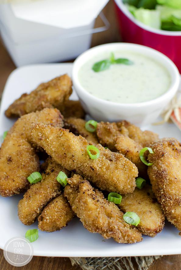 fried gluten free chicken fingers on a plate