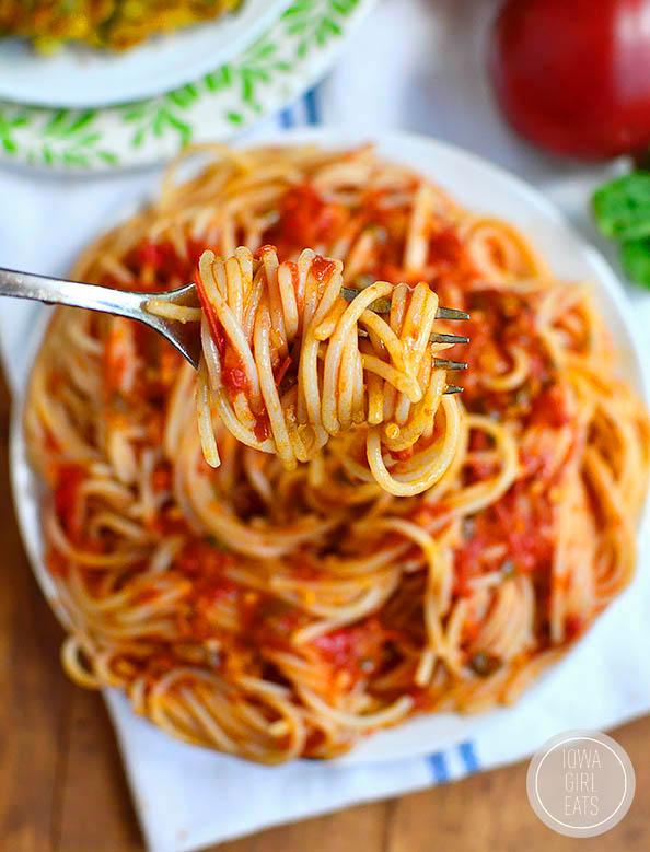 overhead photo of a fork twirling spaghetti al pomodoro