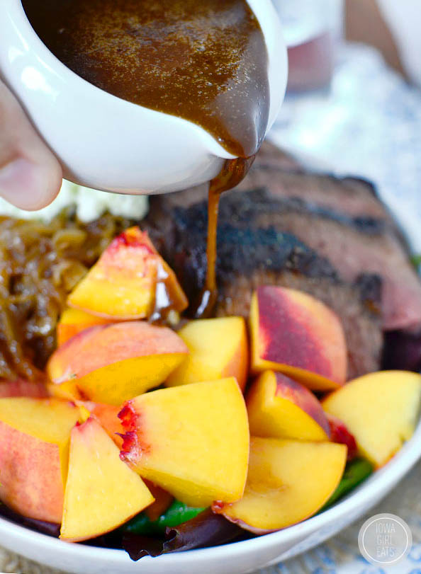 balsamic vinaigrette being drizzled over fresh peaches