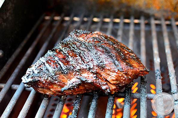 steak grilling on a fiery grill