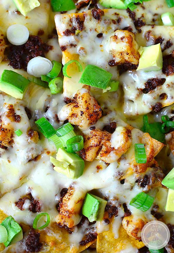 overhead photo of a skillet of shrimp and chorizo nachos