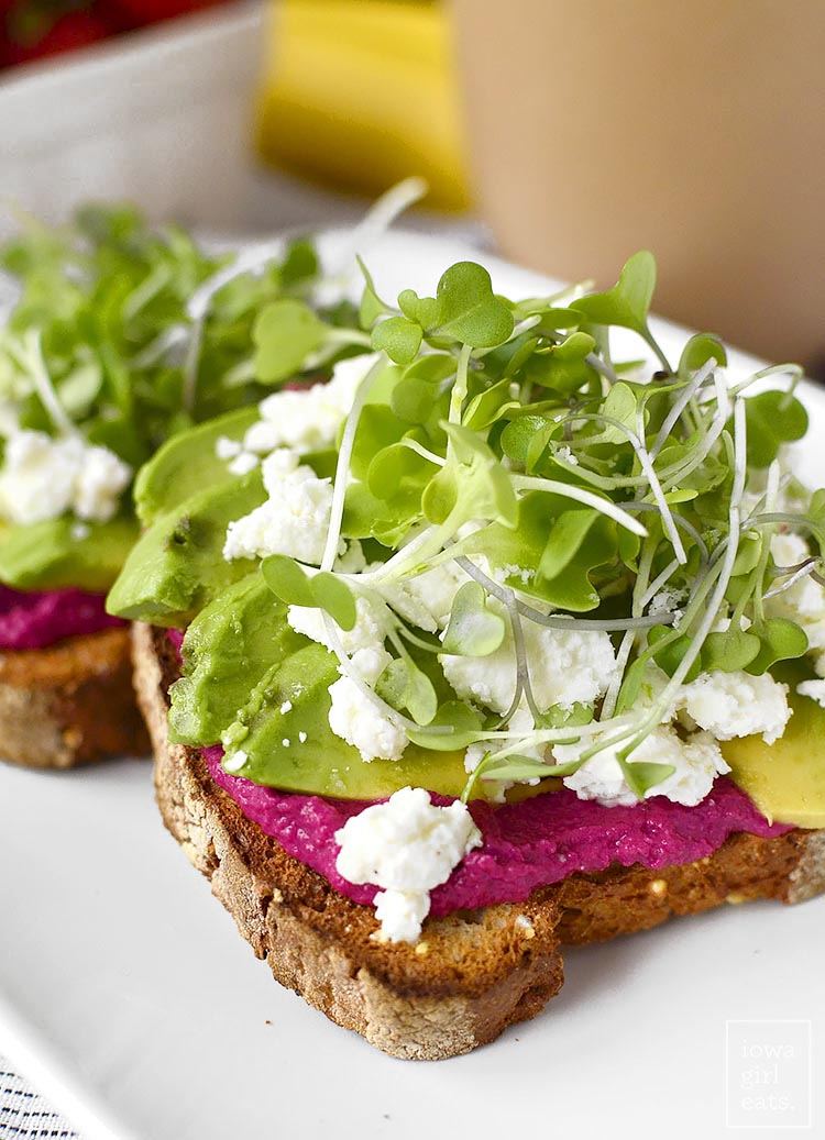 Avocado and Shortcut Beet Hummus Toast is a nutritional powerhouse! Eat for breakfast to power through your morning, or anytime you need a boost. Easily made gluten-free, too! | iowagirleats.com