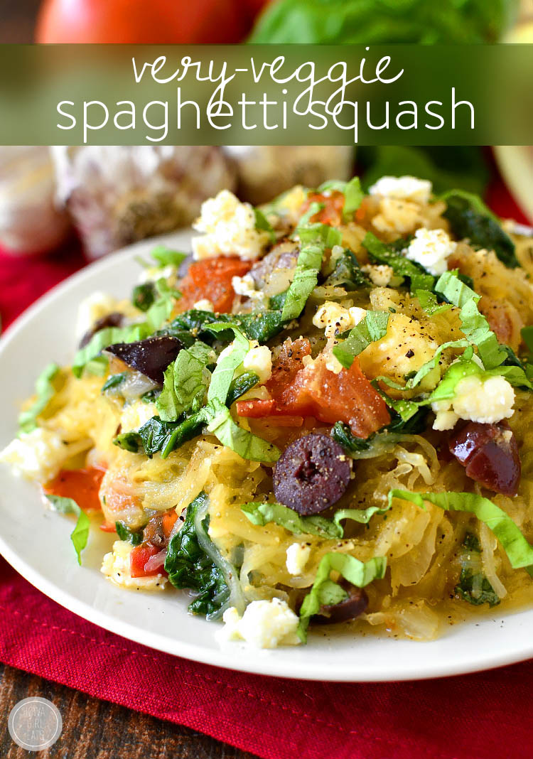 Very-Veggie Spaghetti Squash is a healthy meal packed with vegetables accented with pops of salty cheese and kalamata olives. Fresh and filling! | iowagirleats.com