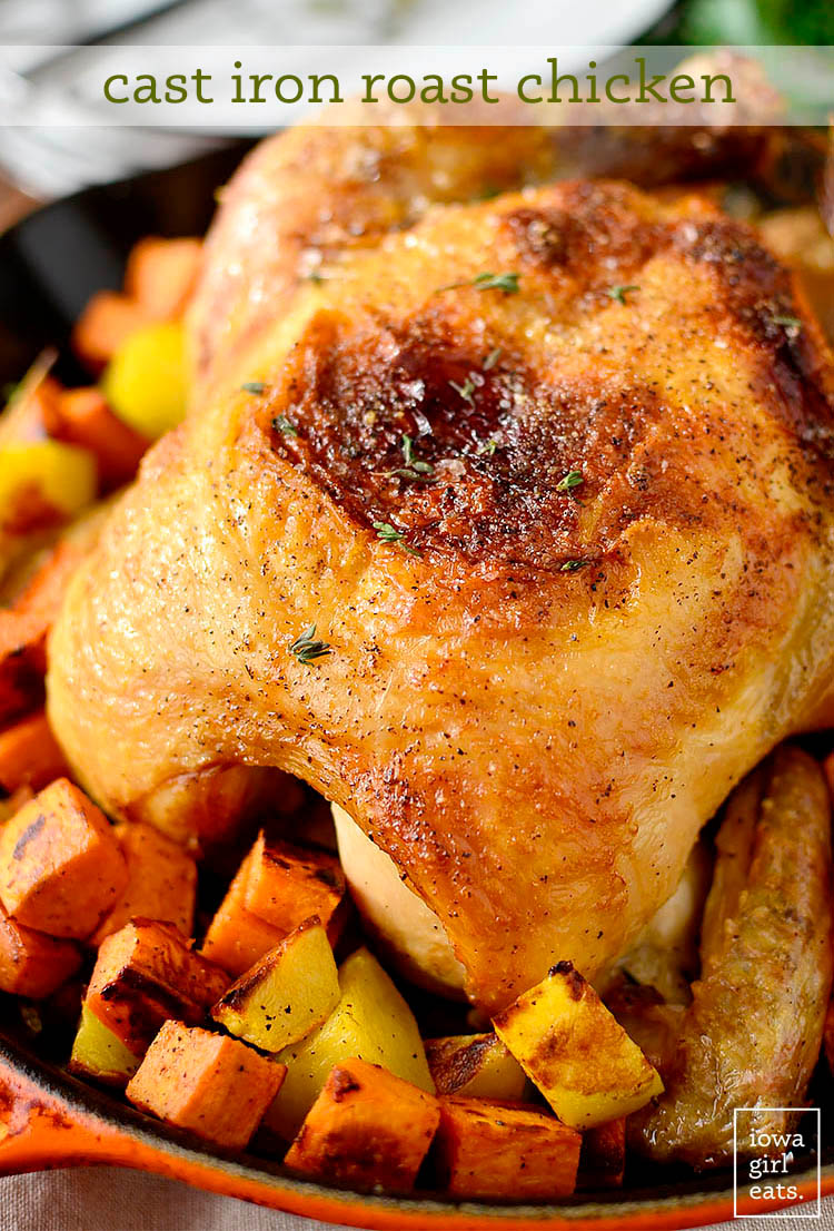 Close up photo of cast iron roast chicken in a cast iron skillet