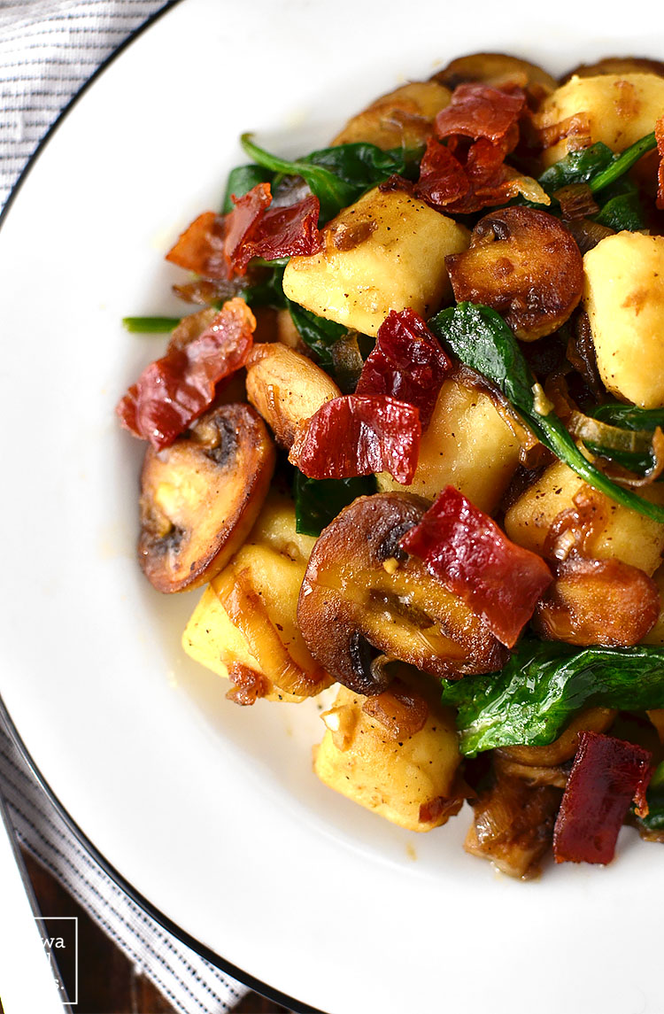 Get your forks ready - you'll be fighting over every last bite of Gnocchi with Spinach, Mushrooms and Crispy Prosciutto. This 30 minute, gluten-free meal is a stunner! | iowagirleats.com