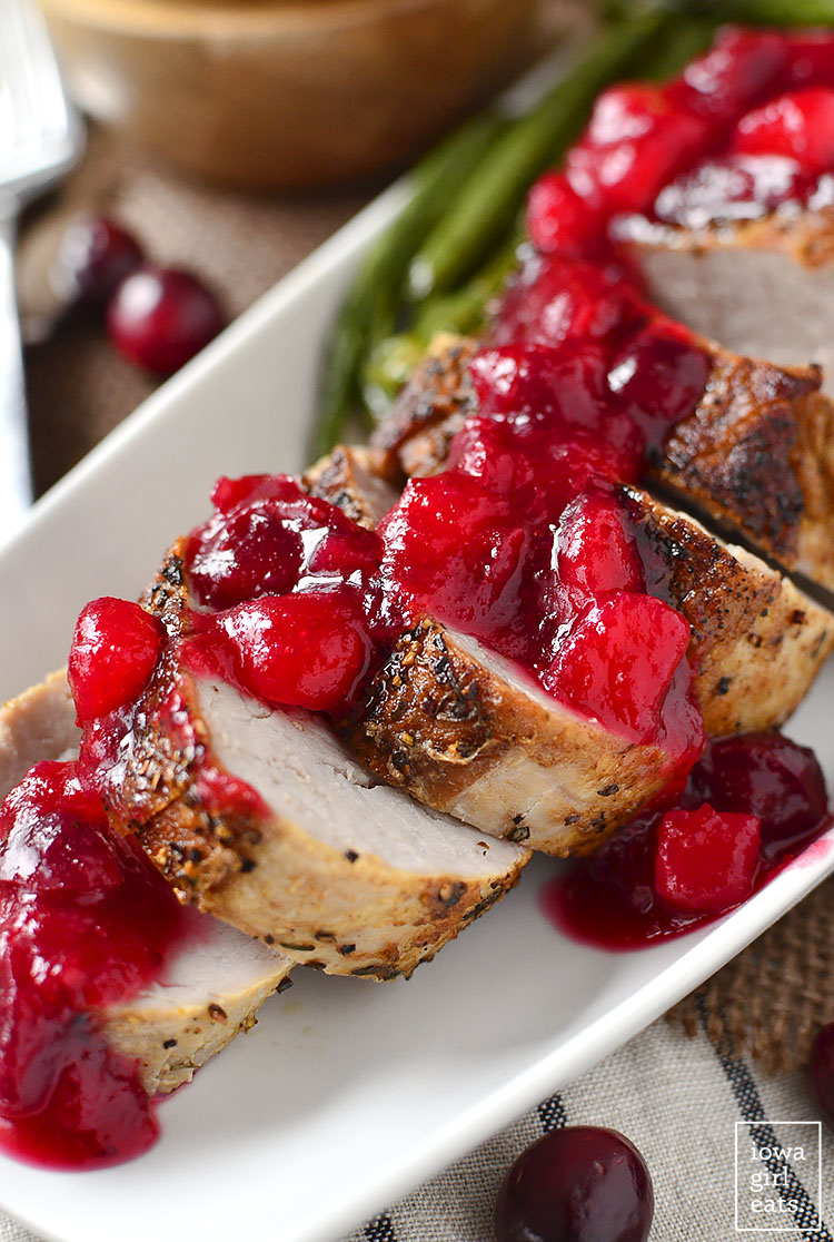 Roasted Pork Tenderloin with Cranberry-Pear Sauce is easy and filling, and features a delicious sweet-tart sauce sweetened without refined sugar! #glutenfree | iowagirleats.com