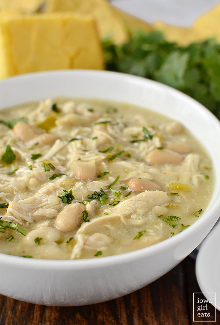 Crock Pot White Chicken Chili is hearty and filling yet low-fat, gluten and dairy-free!   iowagirleats.com