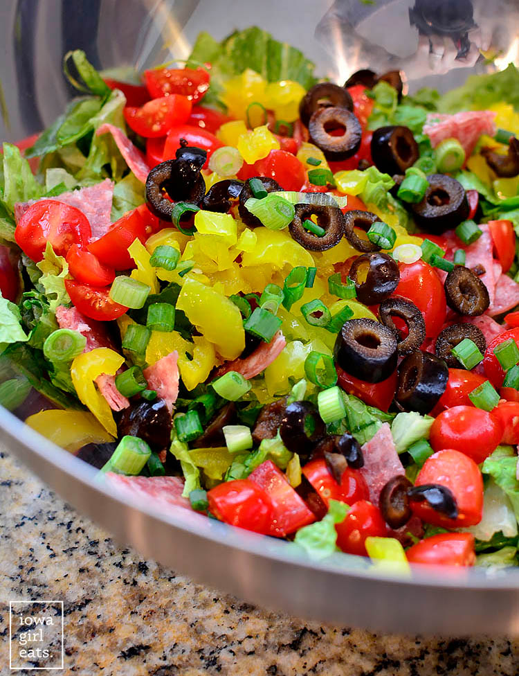 ingredients for italian sub salad in a mixing bowl