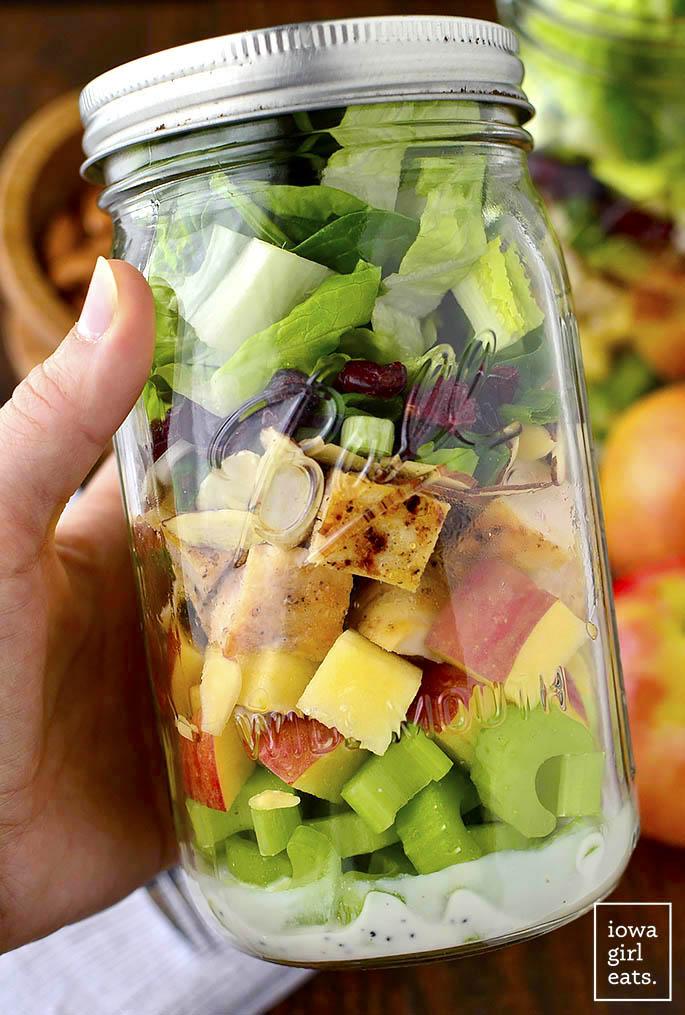 Apple, Cranberry, Almond Mason Jar Salads with homemade Greek Yogurt Poppy Seed Dressing are a fresh, healthy, and easy make-ahead lunch option!   iowagirleats.com