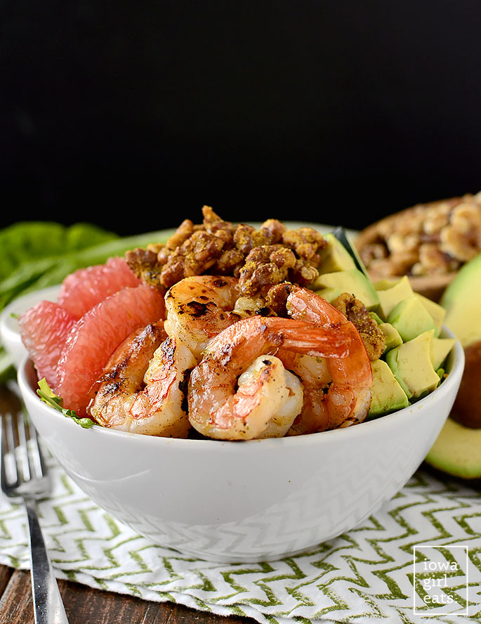 Grapefruit + Avocado Shrimp Bowls with Umami Walnuts are fresh and healthy, with a delicious and addicting walnut topping!   iowagirleats.com