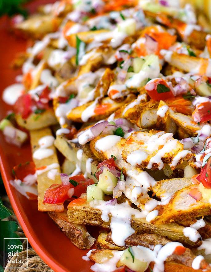 closeup photo of chicken shawarma on fries