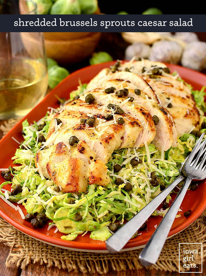 sauteed chicken on a bed of shredded brussels sprout caesar salad