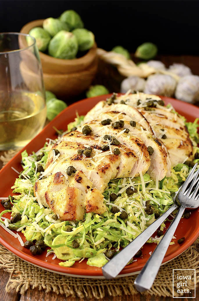 Plate of shredded brussels sprouts caesar salad with chicken