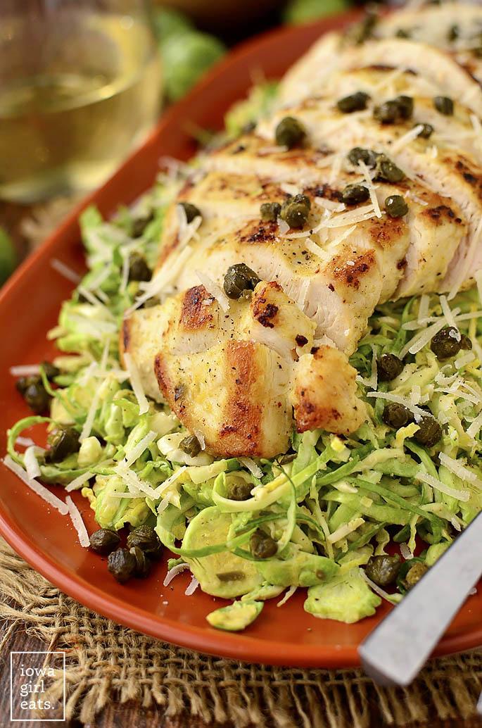 Photo of Chicken on top of caesar salad