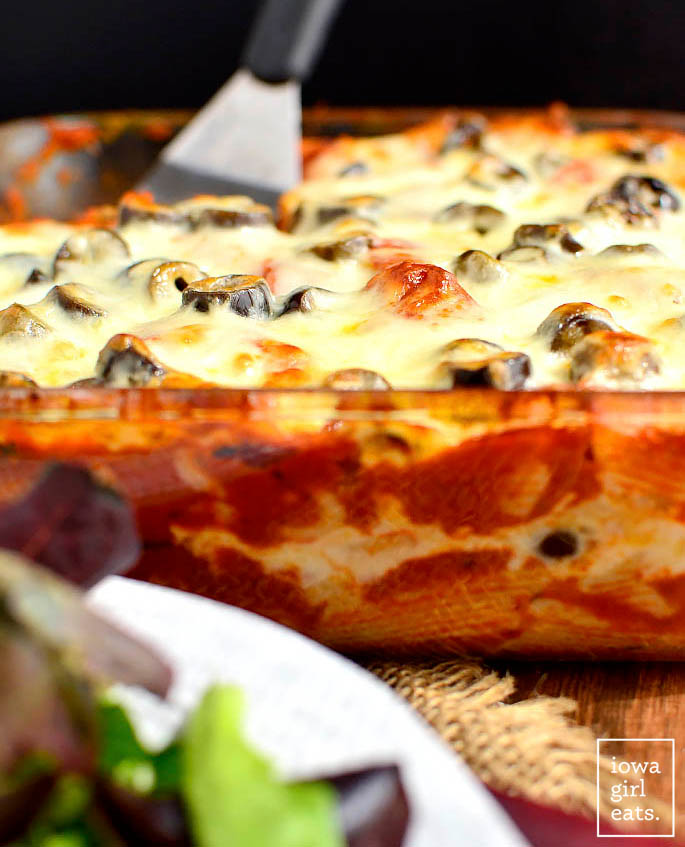 hot and cheesy pizza pasta bake in a casserole dish