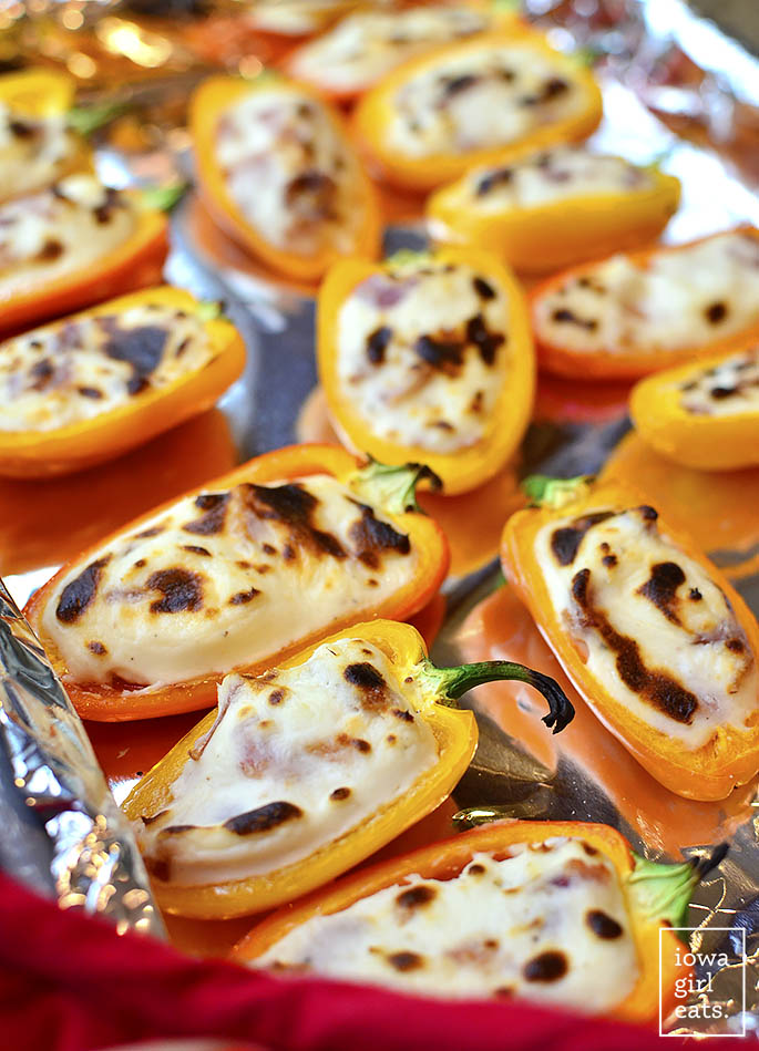 Bacon and Goat Cheese Stuffed Sweet Pepper Poppers are an addicting, gluten-free appetizer recipe. Less than 20 minutes to assemble and cook, and perfect for parties and get-togethers. | iowagirleats.com