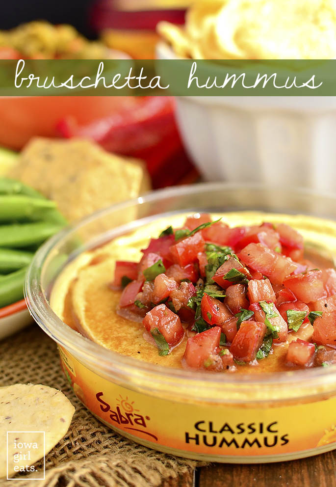 Shortcut Bruschetta Hummus is a quick and easy way to jazz up store-bought hummus. This fresh and healthy snack is absolutely delicious!  iowagirleats.com