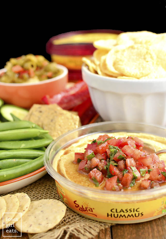 Bruschetta Hummus is a quick and easy way to jazz up store-bought hummus. Fresh, healthy, and absolutely delicious!   iowagirleats.com
