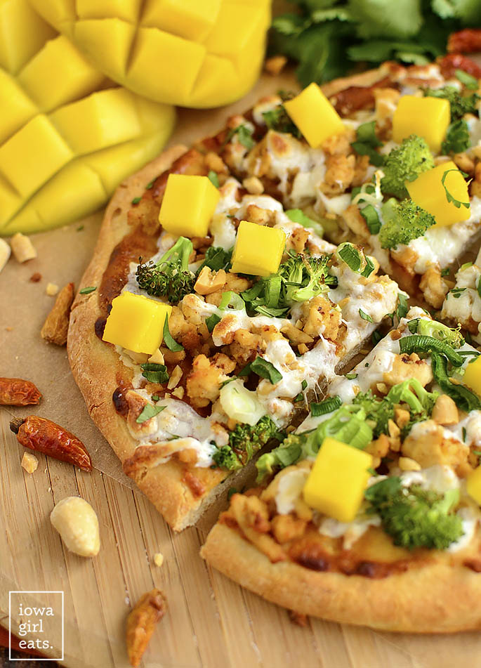 Switch up pizza night with gluten-free Thai Chicken Flatbread Pizza featuring savory peanut sauce, fresh herbs, and sweet mango.