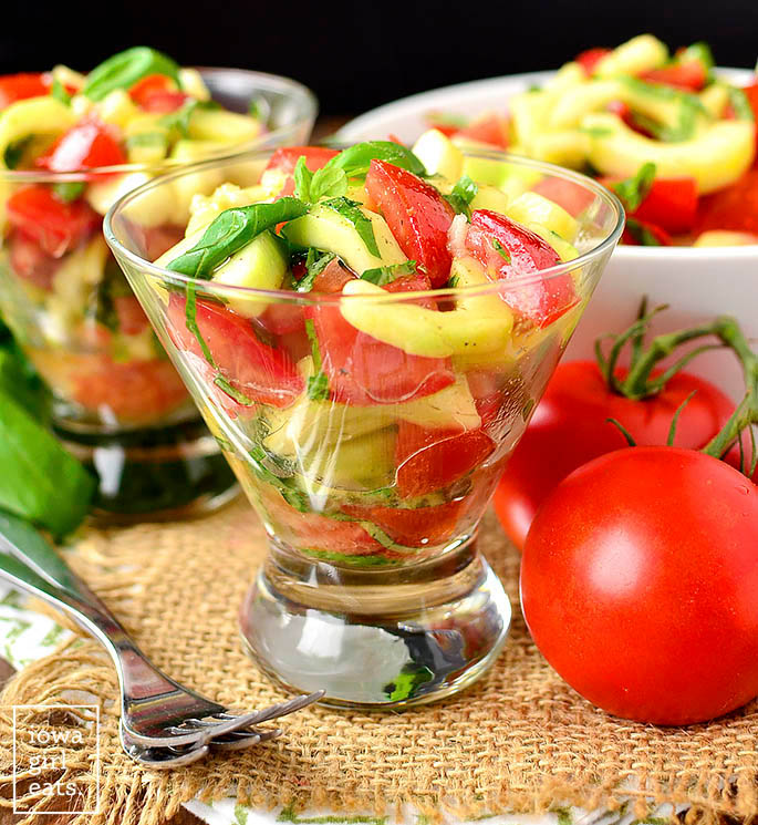 cucumber and tomato salad with italian vinaigrette in glasses