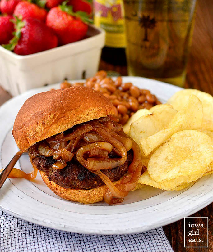 homemade brat burger on a plate with chips
